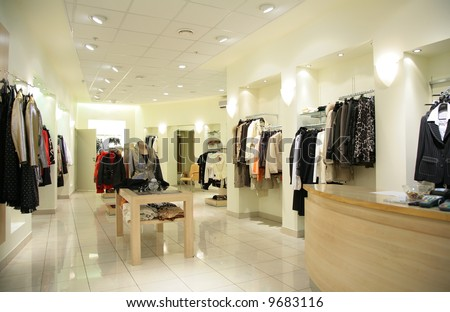 women`s upper clothes in shop - stock photo