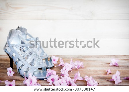 Women's wedding shoes on a wooden floor - stock photo
