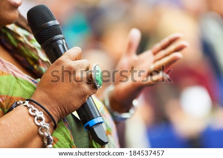 Women Speaking in to the microphone at the conference. Detail - stock photo