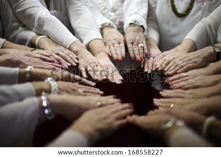 Women team put all hands together - stock photo
