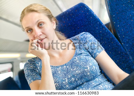 women think about something in a train - stock photo