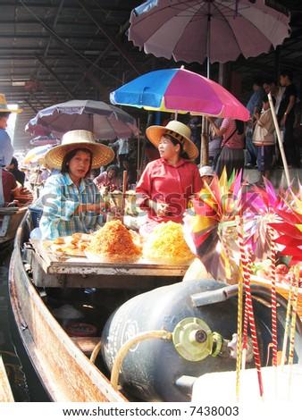 Women Traders, Floating Market - stock photo