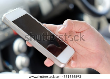 women using a mobile phone in the car - stock photo