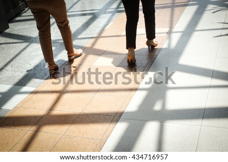Women walking along the footway - Concept background - stock photo