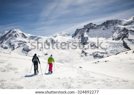 Women walking on ski in the snow mountain. - stock photo