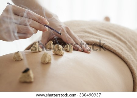 Women who are prescribed the coals on his back - stock photo