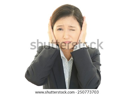 Women who hold the ear  - stock photo