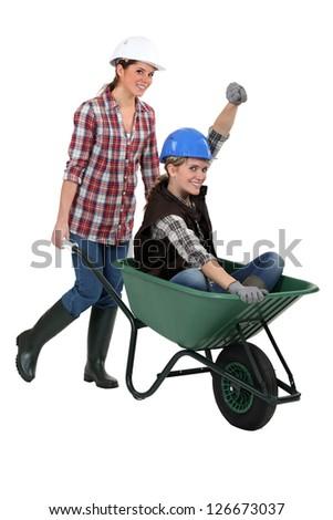 Women with a wheelbarrow - stock photo