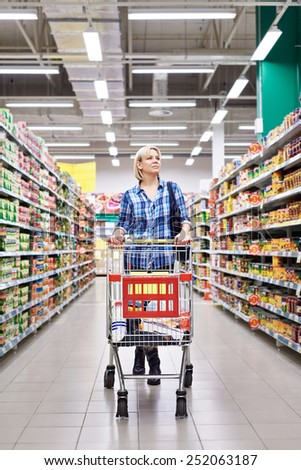 Women with cart shopping in supermarket - stock photo