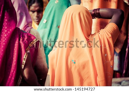 Women with colorful saris in Varanasi, India. - stock photo