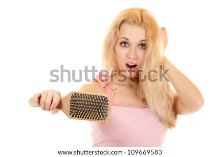 women with hair problem holding loss hair comb in hand, isloated on white background - stock photo