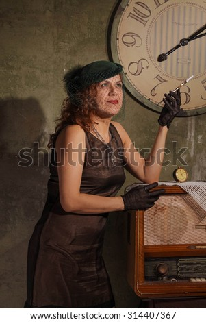 Women with mouthpiece near the clock - stock photo