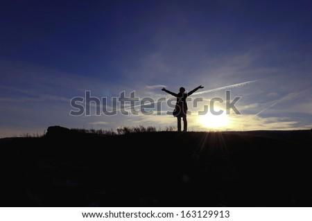 Women with open hands enjoying freedom - stock photo