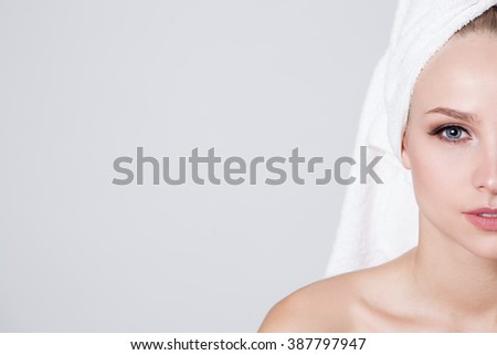 Women with perfect skin and towel on her head - stock photo
