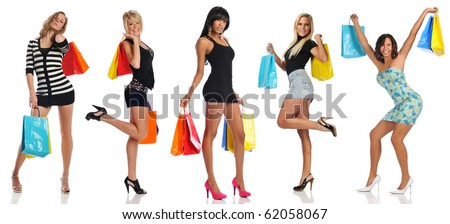 Women with shopping bags isolated on a white background - stock photo