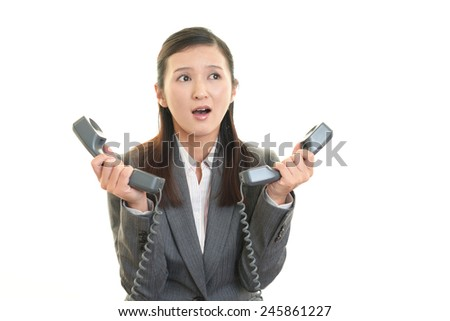 Women with the handset - stock photo