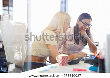 Women working together, office interior - stock photo