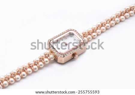 women wristwatches  with pearls on a white background - stock photo