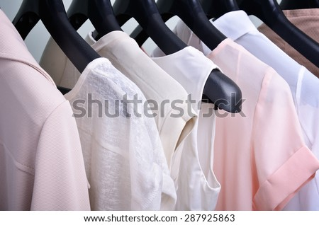 womens clothing pastel colors hanging on the hanger horizontal - stock photo