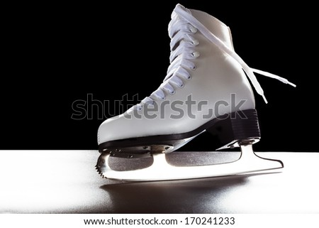 Womens shoes for ice-skate. Shiny blade and dynamically flowing shoelace - stock photo