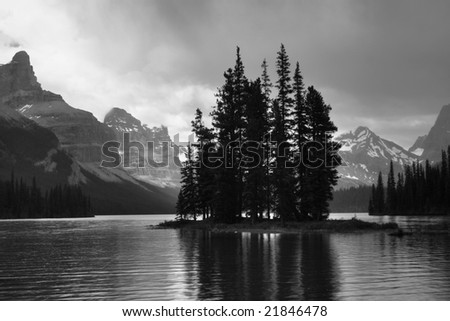 Wonder island in Maligne Lake - stock photo