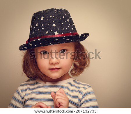 Wonder kid girl in trendy hat looking. Closeup vintage portrait - stock photo