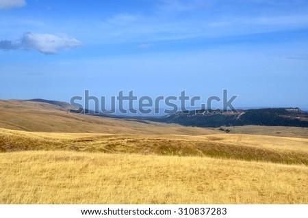 Wonderful autumn landscape at the Lagonacky plateau in the Caucasian Biosphere Reserve, Adygeya, Russia. - stock photo