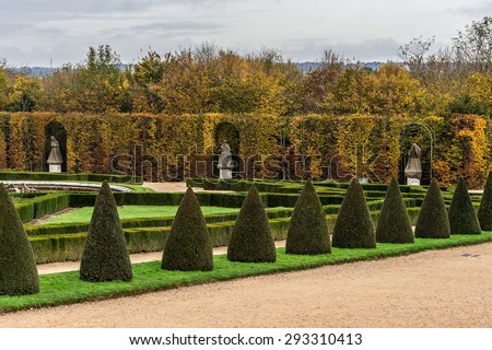 Wonderful autumnal view of famous Versailles Palace Park. The Palace of Versailles was a royal chateau. It was added to the UNESCO list of World Heritage Sites. Paris, France. - stock photo