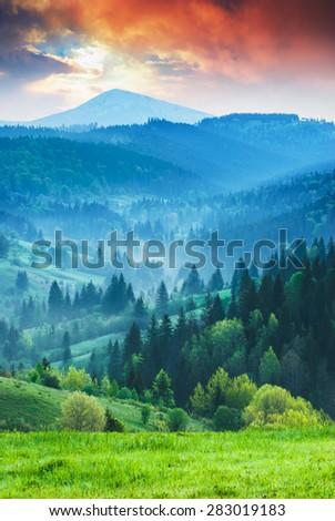 Wonderful Carpathian sunrise with Sivulia mountain in the Ukrainian spring valley. - stock photo