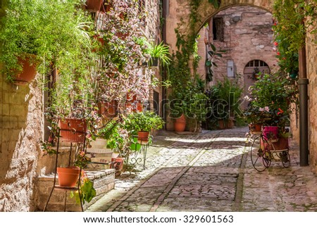 Wonderful decorated porch in small town in Italy in summer, Umbria - stock photo