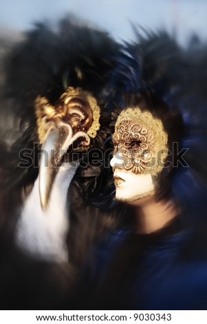 wonderful fashion show of disguised people during the venice carnival in italy (the effect is not a photoshop trick) - stock photo