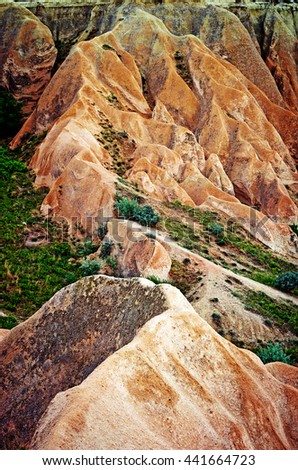 Wonderful mountain landscape carved in volcanic tuff by erosion in Cappadocia, Turkey  - stock photo
