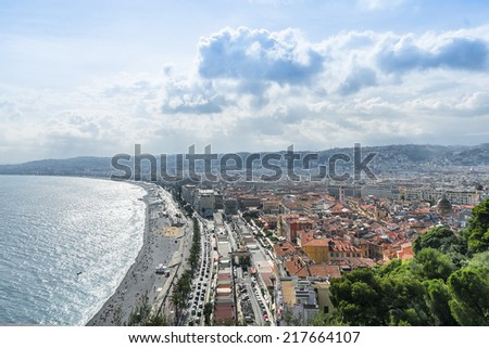 Wonderful panoramic view of Nice with colorful historical houses in Old City and sea. Nice - luxury resort of Cote d'Azur, France. - stock photo