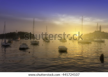Wonderful romantic old town at Adriatic sea. Boats and yachts in harbor in magical summer sunset. Rovinj. Istria. Croatia. Europe. - stock photo
