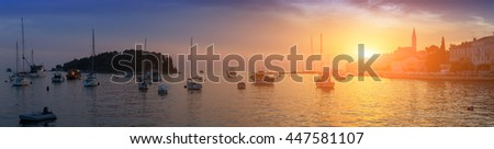 Wonderful romantic old town at Adriatic sea. Boats and yachts in harbour in magical summer sunset. Rovinj. Istria. Croatia. Europe. - stock photo