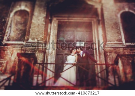 wonderful stylish rich couple kissing hugging on the background  old castle door and Rome Italy - stock photo