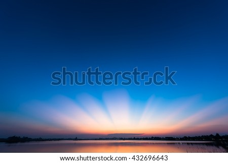 Wonderful sun ray after sunset  over lake, Breathtaking landscape with sunligth after sunset, Beautiful sunset with blue sky - stock photo