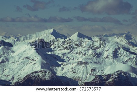 Wonderful view of high snowy mountain against a blue sky.  Rethian Alps, Lombardy, Italy - stock photo