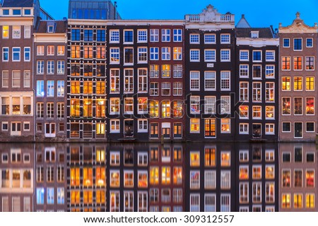 Wonderful view on houses of Amsterdam in night,Netherlands. - stock photo