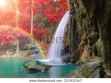 Wonderful Waterfall with rainbows and red leaf in Deep forest at Erawan waterfall National Park, Kanjanaburi Thailand. - stock photo