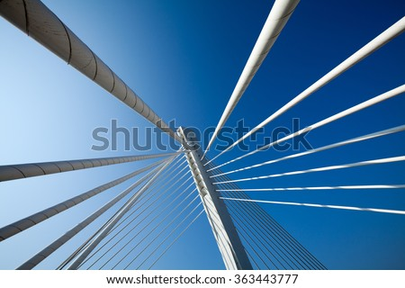 Wonderful white bridge structure over clear blue sky - stock photo