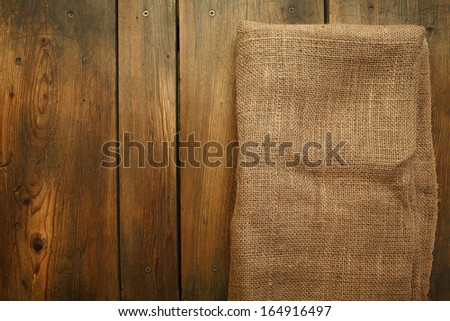 Wood and sackcloth texture/Cookbook background. Wood Table with jute coarse grain canvas texture ( seamless sackcloth ). - stock photo
