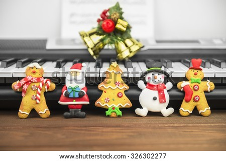 wood background Christmas tree cookies, santa, middle-aged man, snowman, snowflake, candy. New year food - stock photo