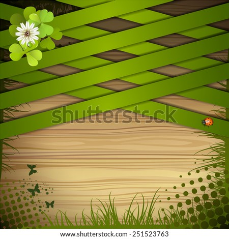 Wood background with clover and green strips - stock photo