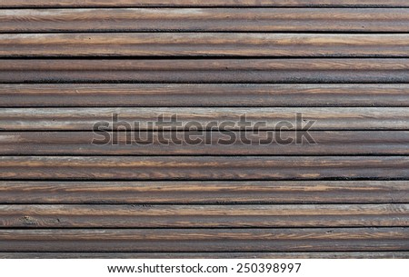 Wood background with horizontal dark brown, tarred planks. - stock photo