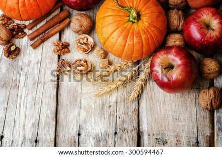 wood background with pumpkin, apples, wheat, honey and nuts. the toning. selective focus - stock photo