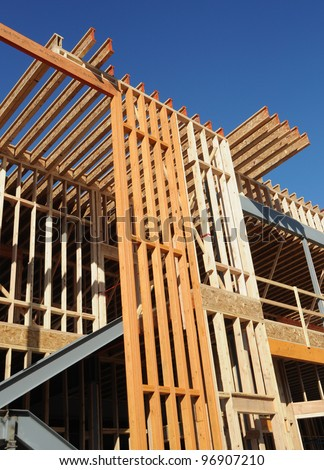 Wood Beam Structure and Construction Site - stock photo
