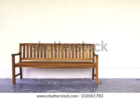 wood Bench Against blank Wall. - stock photo