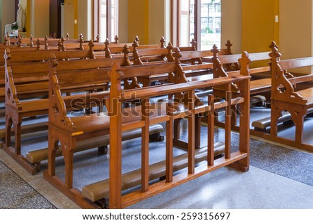Wood Bench of Catholic church, people can pray for god jesus - stock photo
