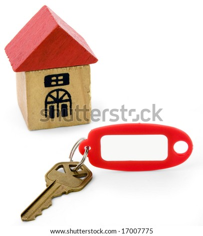 Wood-blocks house, key and red keytag. - stock photo